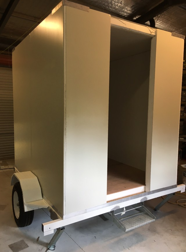 trailer with walls and roof
